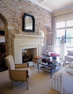 See thru fireplace in between living room and dining room...love the exposed brick
