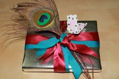 """Catching up on my beloved """"craft"""" #diy #giftwrap #ribbon #feathers"""