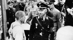 The History Place - Triumph of Hitler: Dachau Opens Himmler and a prisoner. These people had committed no crimes. Why did Germany need to drag them from their homes and lock them in cattle cars? World History, World War Ii, History Major, The Third Reich, Paratrooper, Red Army, Historical Photos, Wwii, Atlanta