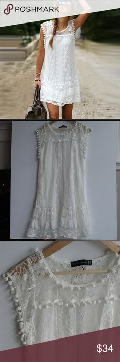 """NWT Zanzea Collection White Lace Dress - Sz 8 NWT (new with tags!) Zanzea Collection white lace dress with pom pom details on arms, neckline and across front. Size 8. Dress did not come with a tag indicating fabric type, but outer layer is lace and lining appears to be a white, stretchy polyester/nylon type fabric. This dress is gorgeous!! Lay flat measurements: Chest: 34"""" Length: 34"""" If you have any questions at all, please let me know! Zanzea Dresses Midi"""