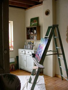 Easel out of ladder. Make a platform/ledge that turns any ladder into an easel.