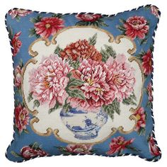 Showcasing a needlepoint design and peony motif, this lovely pillow adds a stylish touch to a neutral-hued sofa or settee.  Product:...