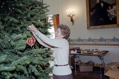 DECK THE HALLS.  First lady NancyReagan decorating the White House Christmas tree