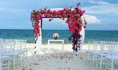 Beautiful Bougainvillea Flowers Canopy for a Beach Wedding #nowsapphire #nowresorts #nowsapphirewedding #destinationweddings #beachweddings #Bougainvillea #wecreatememories #acuareladesigns