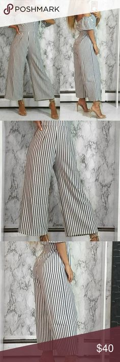 Stripe Off The Shoulder Culotte Jumpsuit So cute & chic ! Strapless short drop sleeve shoulder gray and white pinstripe woven romper.   - 96% Polyester | 4% Spandex  - Back zip  ✔Vixen is a licensed e-commerce business  ✔All items are new from our boutique ✔Quality items, sourced in USA only ✔You are purchasing the actual product on model  ✔Price firm unless bundled/15% off 3 items ✔Lowball offers declined immediately Pants Jumpsuits & Rompers