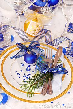 Christmas Table Setting In White And Blue Colors