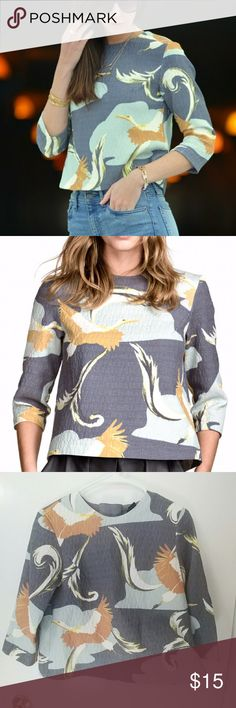H&M Crane Pattern Blouse A navy toned grey background with hues of ochre and powdered blue-grey. Fresh but warm. I can see this with white cigarette trousers and barely there heels. A great piece to kickstart your spring wardrobe. H&M Tops Blouses