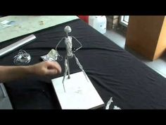 Iron wire x man sculpture.mp4 - YouTube