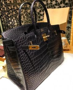 This beautiful handbag made of genuine alligator leather in the classic  black, purple, dark red color, an always fashionable tonality, thus perfect  for ... fc488fd5dc