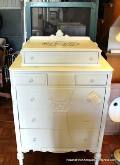 Love this creamy white dresser with six drawers and a stenciled top. So well made and sturdy. (250.00) Sold