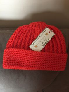 Carrie's Crochet Creations  Ponytail Messy Bun Beanie Toboggan Hat    $15 + shipping without bow, $17 + shipping with removable bow  (513) 659-3309