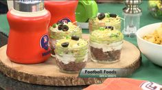 7 layer dip with refried beans, sour cream, gaucamole, pico de gallo, cheese, black olives and green onions.   Recipie at: http://link.kwgn.com/1arLAPl