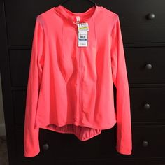 Under Armor Florescent pink all-season gear You will definitely be seen in this Florescent pink jacket either working out or staying comfy and dry. Lightweight and aerie with a sheer back, arms and shoulder breathability. Under Armour Jackets & Coats