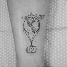 I like the world on this tattoo but not so much the bag with the heart
