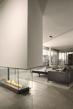 Something like this, yes! Fireplace in the middle of the wall and giant windows..