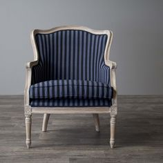 Classic contouring, contrasting leg designs and the comfort of cotton combine to create the Charlemagne Traditional French accent chair. Cedar wood frame and distressed brown oak wood finish with white streaking celebrate this timeless design.