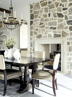 Fireplace, slate floor, white stoneware dishes. Good combination for a sun room!