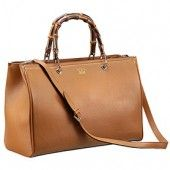 The glossy bamboo handles lend a sophisticated look to the tan leather exterior of this Gucci shopper tote