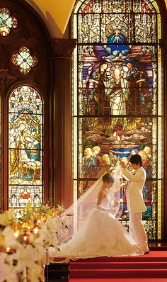 This chapel is in Midosuji Honmachi, Osaka Japan. St. Raphael Chapel..... How beautiful and love the Stained Glass Windows!