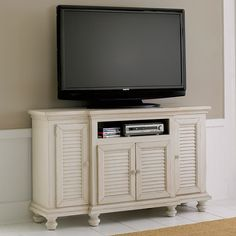 "Porter Ridge 60"" Louvered Ivory TV Sta 