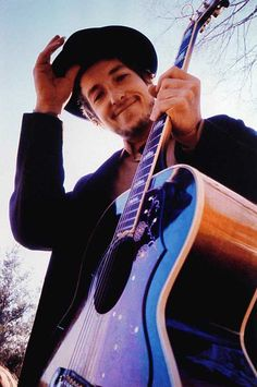 "Bob Dylan, from the cover of ""Nashville Skyline.""(I love this pic. It showcases his rare smile. He didn't smile much for photos, but when he did..wow...it was bright! j.g.)"