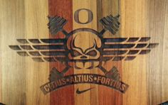 Citius Altius Fortius (Faster Higher Stronger)  Moto carved into Olympic lifting platforms in  Weight room floor at UO Hatfield Dowlin Complex  WTDPhotography.com By Russell Long