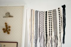 Woven bands.  I'd love to have some of these hanging up in our house!  By Karen Barbe.