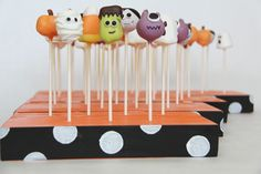 cakepop stands and adorable cake pops. I cannot wait for Halloween so that I can make these!