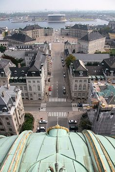 Copenhagen, Denmark with the royal palace complex in the middle and the opera house in the background across the water