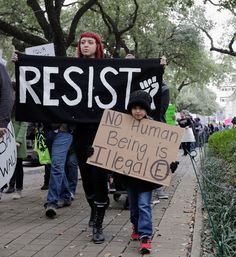 Tech Giants Voice Concern Against Travel Ban: Siliconeer Editorial February 2017 Protesters gather at City Hall and march to Minute Maid Park to protest President Donald Trump, in Houston, Texas, Feb. 4. (Tim Warner/Getty Images)    Silicon Valley tech giants joined the court in a legal battle against President Donald Trump's controversial immigration restrictions. – @Siliconeer #Siliconeer #Trump #TravelBan #SiliconValley #Tech #Apple #Facebook http://siliconeer.com/curr