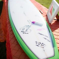 Surfboard Guest Book...how have I not thought of this yet? one thing he might totally buy into!!
