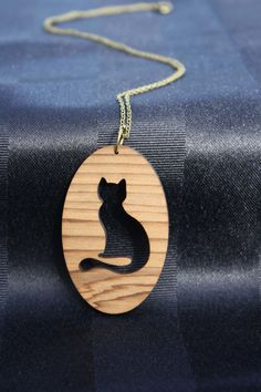 Lasercut cat silhouette necklace by MultiverseDesignsNZ on Etsy https://www.etsy.com/listing/222570067/lasercut-cat-silhouette-necklace