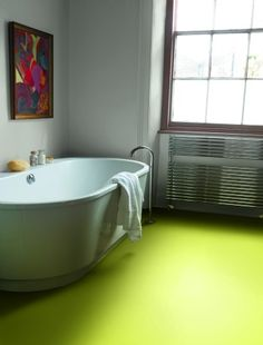 Inspiration from Bathrooms.com: If you've got an all-white room, a burst of colour on the floor