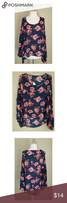 "Blue Floral BOHO Blouse Rue 21 rue 21 Blue Floral Blouse with trumpet sleeves, scoop neckline, hi-low style. At mid sleeve the Blouse has blue crotchet lace detail.  Bust: 19"" flat across, Waist: 20"" flat across, Length: front 24"" Back 30"". Adorably Adorable ✨✨ Navy with Coral and Taupe. Rue 21 Tops Blouses"