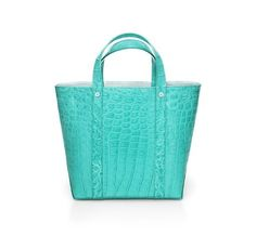 I should have this purse... actually I should have everything Tiffany blue related