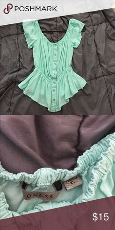 Guess turquoise blouse. CHEAPER SHIPPING ❤️❤️❤️ Waistline is stretchable. I am 5'3 and it hit right at my hips. Frilly short sleeves, boat neck, looks like peplum top. Wear once or twice! In good condition. Chat with me for negotiation. Bundle with any items in my closet for discounts and cheaper shipping price! Guess by Marciano Tops Blouses