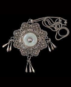 Southern China or Vietnam   Silver and nephrite pendant   Early 20th century   Sold