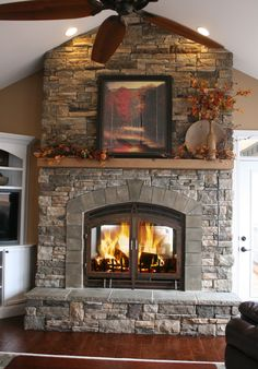 Floor-to-Ceiling stone fireplace with full-width wood mantel