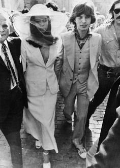 Bianca Jagger wed Rolling Stone Mick in 1971. Jaws dropped when folks saw her unexpected fashion statement: A white pantsuit (apparently with nothing underneath) and a floppy, oversize hat.
