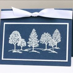 Embossed white trees really pop when set against a navy background.  A peaceful winter time card.