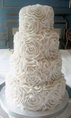 wedding cakes- needs some natural color added in succulents or flowers to me, but it's beautiful