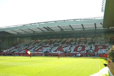 LIVERPOOL, ENGLAND: Saturday, May 15, 2004: Liverpool fans make a mosaic on the Spion Kop before the final Premiership game of the season at Anfield. (Pic by David Rawcliffe/Propaganda)