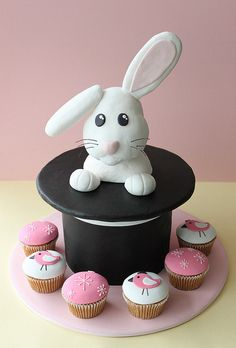 Magic Bunny    Bunny in a hat with cupcakes, both made to match an invite.    www.weelovebaking.com