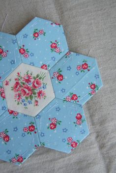 Hexagon quilt in progress by Three Honeybees, via Flickr.