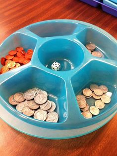 This game is VERY simple but powerful for the kids because it helps them to make those connections that 5 pennies = 1 nickel, 2 nickels = 1 dime, etc... Each student has a gameboard and there is one student in each group that I select to be the banker. I love using these chip trays to organize manipulatives! Gotta love the Dollar Tree! :)