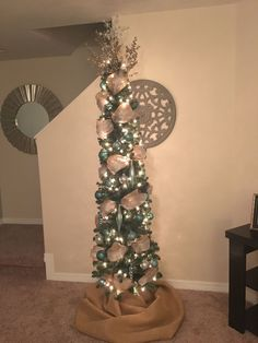 pencil christmas tree with shades of blue ornaments burlap gold and silver ribbons burlap diy tree skirt