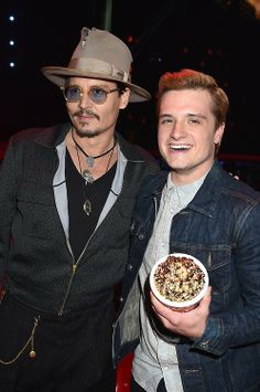 Johnny Depp poses with Best Male Performance winner Josh Hutcherson.
