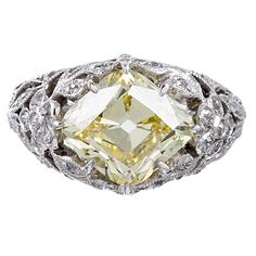 Fancy Intense Yellow Rhomboid Diamond Ring   From a unique collection of vintage engagement rings at http://www.1stdibs.com/jewelry/rings/engagement-rings/