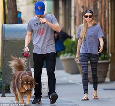 Out and about: Amanda Seyfried and her boyfriend Justin Long looked very much in sync with...