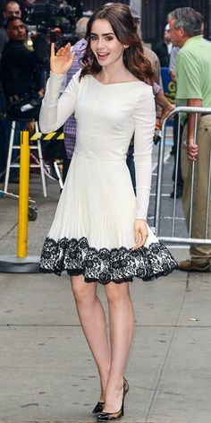 Lily Collins a Valentino dress, JIMMY CHOO pumps, Dana Rebecca Designs studs and a Jacob & Co. cocktail ring. Styled by #RandM.